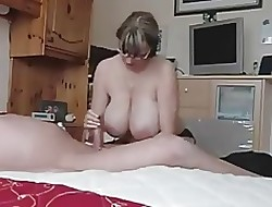 Hot MILF in all directions Weighty boobs strokes an elderly cock.
