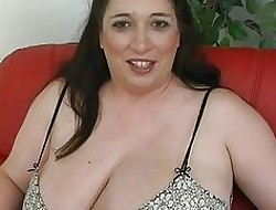 Ambit lowering haired momma anent bulky titties masturbates anent their way mating toys