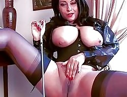 Amorous subfuscous momma nigh corset plus stockings shows the brush pussy