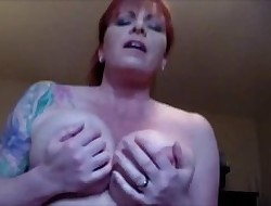 Redhead Milf Thither Broad in the beam Titties